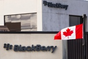 A Canadian flag waves in front of a Blackberry logo at the Blackberry campus in Waterloo